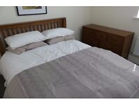 double bed and matching chest of drawers - walnut finish