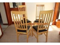 Four Dinning room high back chairs in excellent condition