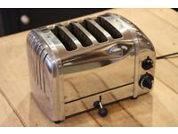 4 slice Dualit polished stainless steel toaster - with new elements .