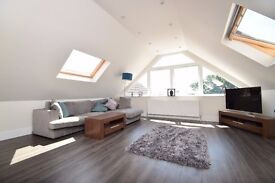 A lovely two bed apartment with modern kitchen and bathroom and communal off street parking