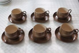 Six Denby cups and saucers