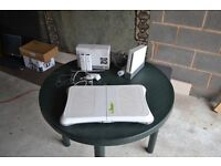 Nintendo Wii with Wii Fit and various accessories.