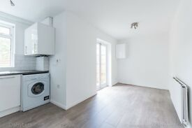 Attractive two bed terraced townhouse, integrated garage on popular Jennings Road in East Dulwich.
