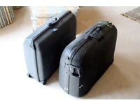 Samsonite hard shell suitcases, wheels used but very serviceable, combination locks