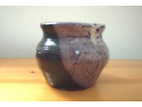 Heavy hand-thrown studio pottery pot with glaze in shades of purple. £1.50