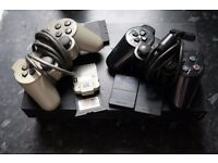 Sony Playstation 2 console bundle with games, memory cards and two controllers. All cables included