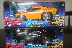 Die cast Muscle machines 1/18 scale Cuda 70 and 69 Camero