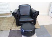 black leather sofa and stool