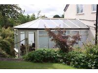 Hardwood conservatory, double glazed, polycarbonate roof.