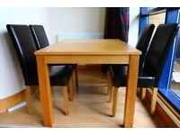 BRAND NEW! SOLID WOOD EXTENDABLE DINING TABLE AND 4 FAUX LEATHER CHAIRS. DIMENSIONS: 80 x 76 x 130cm