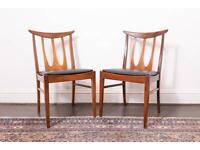 Two mid-century G Plan Teak Brasilia chairs, newly upholstered