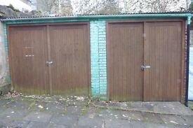 Two pairs of natural wood garage doors.