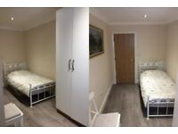 2 large room to rent with small family house close to shops trains etc