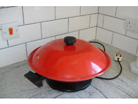 Meyer Electric Wok, easy dial for heat settings.Bright red.