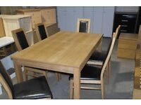 BRAND NEW DINING TABLE WITH 6 OAK AND LEATHER CHAIRS!!!!!