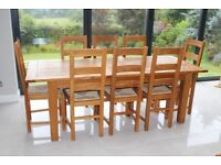 Extendable Solid Oak Dining table with 8 solid oak (wicker seat) dining chairs