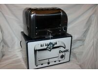 Boxed Dualit 4-slot Vario/Classic toaster in polished stainless steel/solid aluminium. As new.