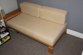Single sofa bed with removable covers and small arm storage