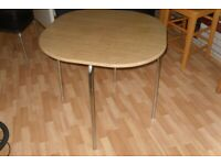 Small dining table and four chairs