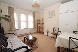 ONE MINUTE WALK TO SOUTHGATE TUBE STATION. A two bedroom split level flat on Southgate High Street