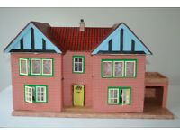 Dolls House circa 1950s with furniture has light in the back requires battery