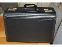 Sturdy briefcase, with twin combination locks