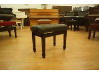 New adjustable piano stool in black with leather top. Can be posted