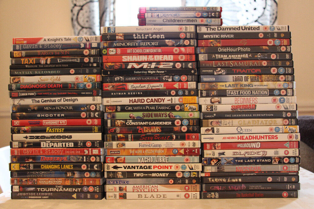 71 assorted DVDs for sale.