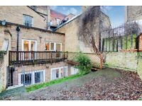 Spacious 2 bed flat split over 2 levels with terrace patio and landscaped garden in Islington N1