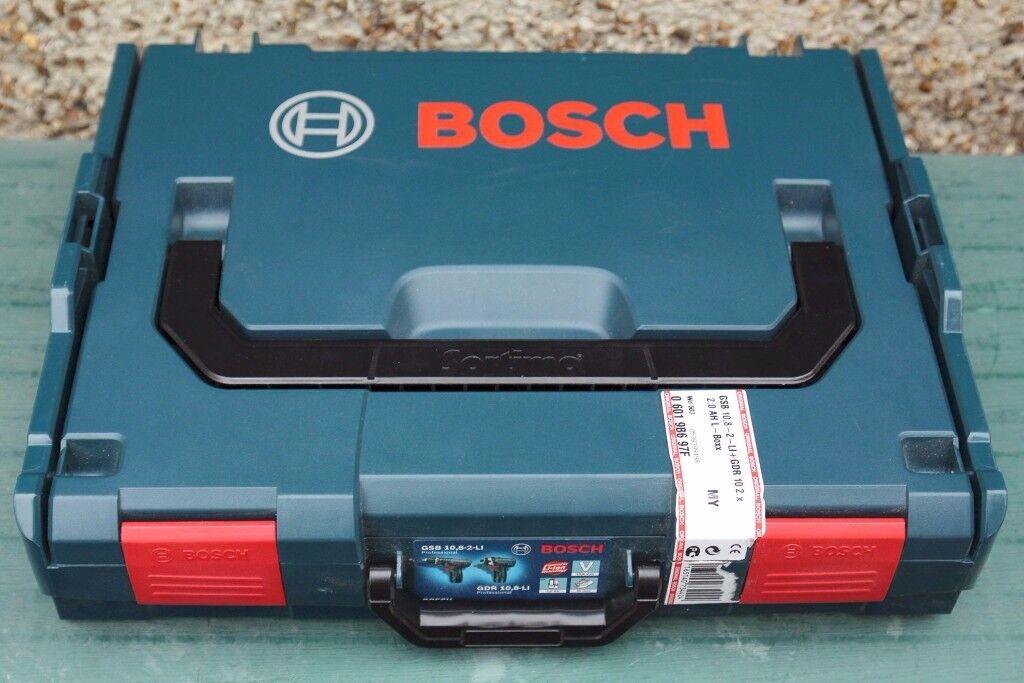 Bosch Professional (blue) 10.8v driver/hammer drill + 2x 2AH batteries, still under warranty!