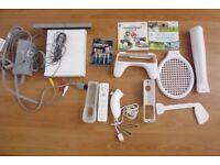 Wii + Mario Kart, Wii Sports, controllers, batteries, venom pack, etc
