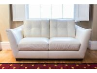 Natuzzi white Italian leather sofa and 2 matching chairs.