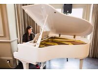 Singing Lessons and Piano Lessons in Urmston Home Studio Available - Qualified and Experienced Tutor