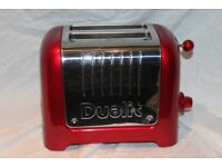 Dualit 2-slot Lite toaster in polished stainless steel and metallic red. Used once.