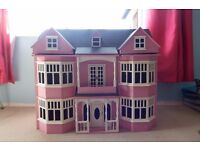 Large pink victorian dollhouse