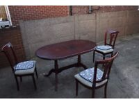 Extendable table with three chairs