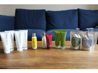 Selection of travel-sized shampoo, conditioner, body wash and lotion