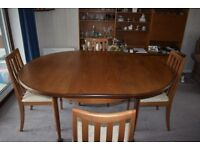 Dining room table and 4 chairs, extends to seat 6 comfortably
