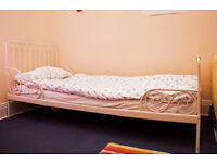 IKEA Minnen extendable single bed with white metal frame