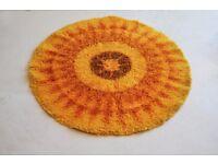 1970's mid century radial patterned bright orange Axminster 100% wool rug