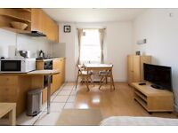 Third floor MODERN FURNISHED studio apartment with open plan kitchen and en-suite shower/WC