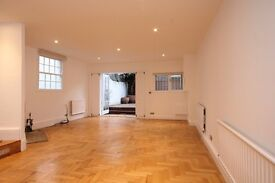 A Large three bedroom house with two reception rooms and private garden to let in Fulham.