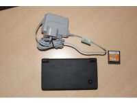New Nintendo Dsi with official charger and game