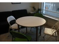 Habitat, Suki 2- 4 seat white folding round table + 4 chairs (two white and two green)