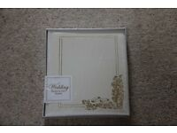 cream tradional style wedding album. new
