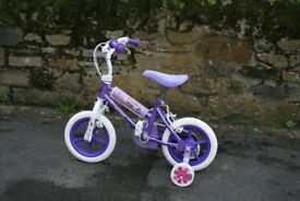 "Girls First Bicycle. Used only once, this 12"" wheel bike is in purple & pink, with Stabilizers."