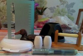 Seven different household items including salt and pepper pots, remote control holder, dvd holderetc