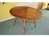 Ercol - Round drop leaf table and four chairs
