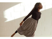 Two Muji, soft Indian cotton skirts, double layered to create the full-look hem.
