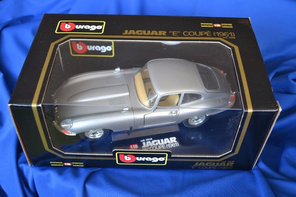 Burago 1/18 scale model cars all in very good conditionin Folkestone, KentGumtree - BURAGO Diamond 1/18 Scale 1961 Jaguar E type Coupe in Black. Cod 3018 Car has opening bonnet, boot and both doors. detailed engine, Steerable wheels, Box in great condition, Car has only been out of box for photos. £20 BURAGO Diamond 1/18 Scale 1961...
